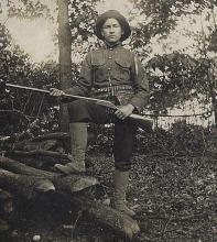 antique photograph man with weapon gun
