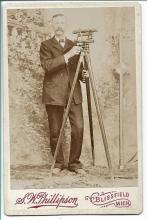 rare photograph of a surveyor with his instrument