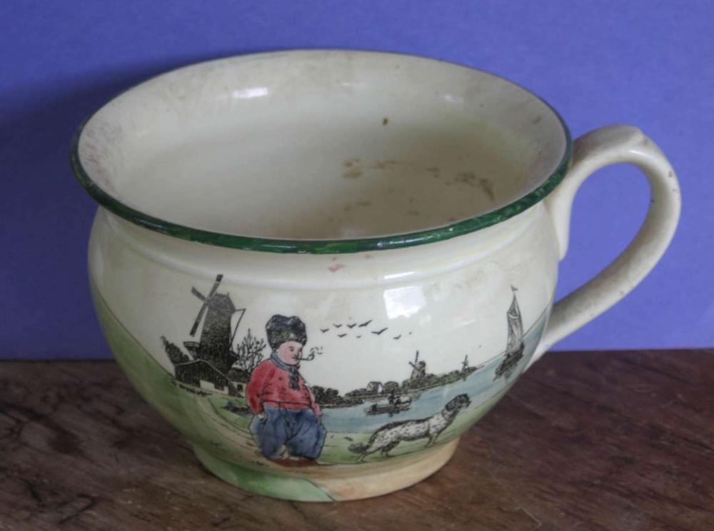 vintage or antique large porcelain cup with Dutch scene