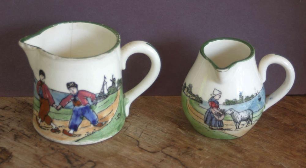 pair vintage or antique Dutch scene porcelain pitchers