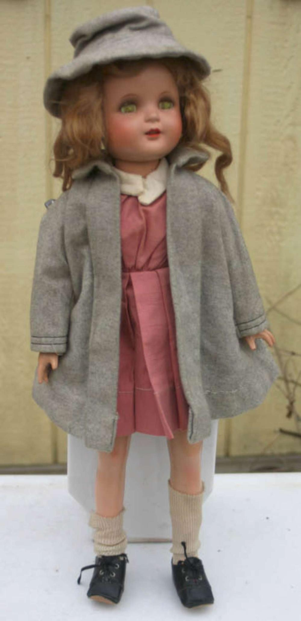 vintage or antique doll with period clothing
