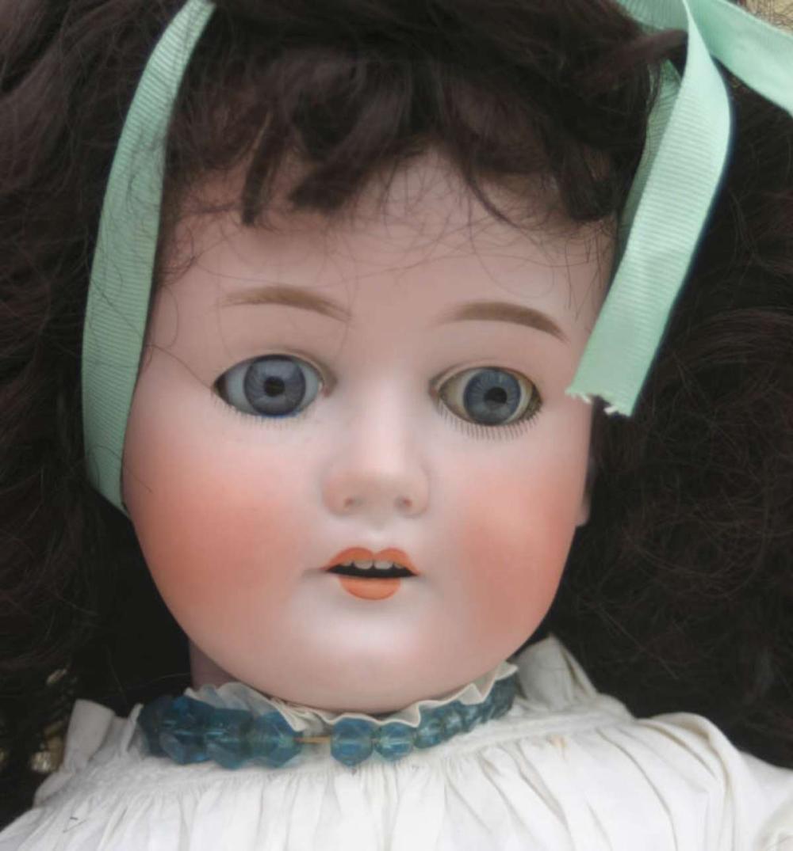 antique bisque or porcelain head doll