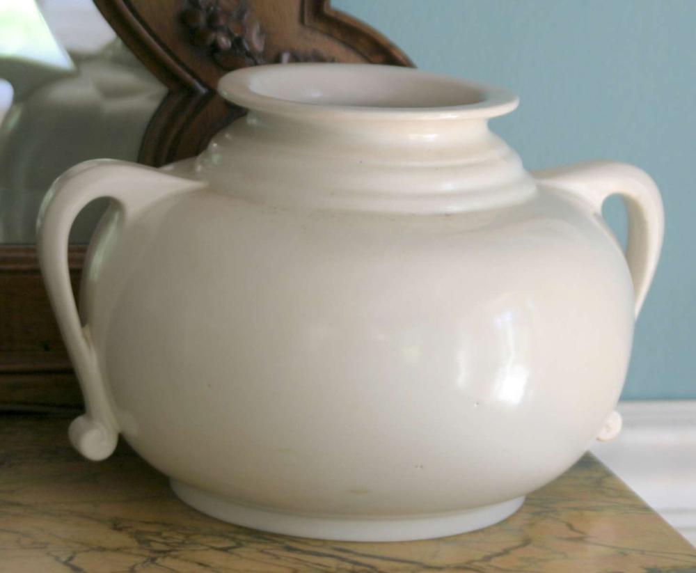 Roseville matte finish cream colored vase
