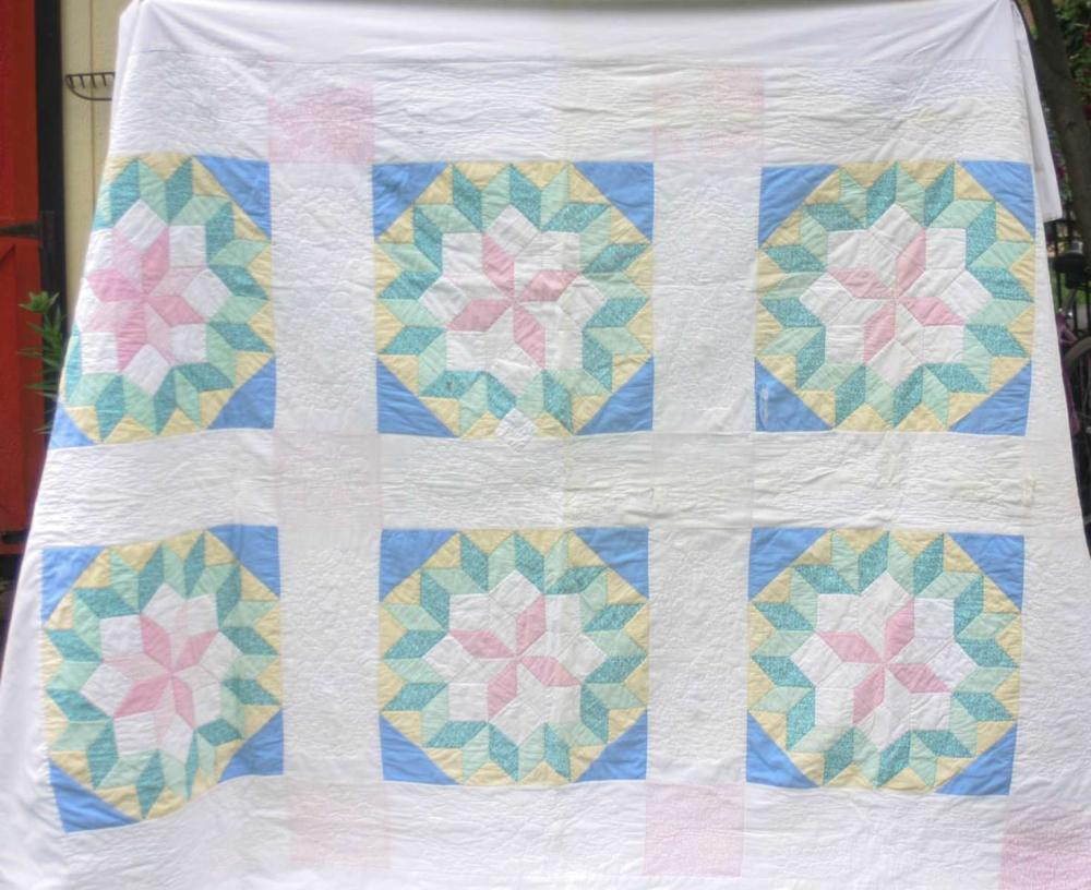 vintage or antique hand sewn quilt