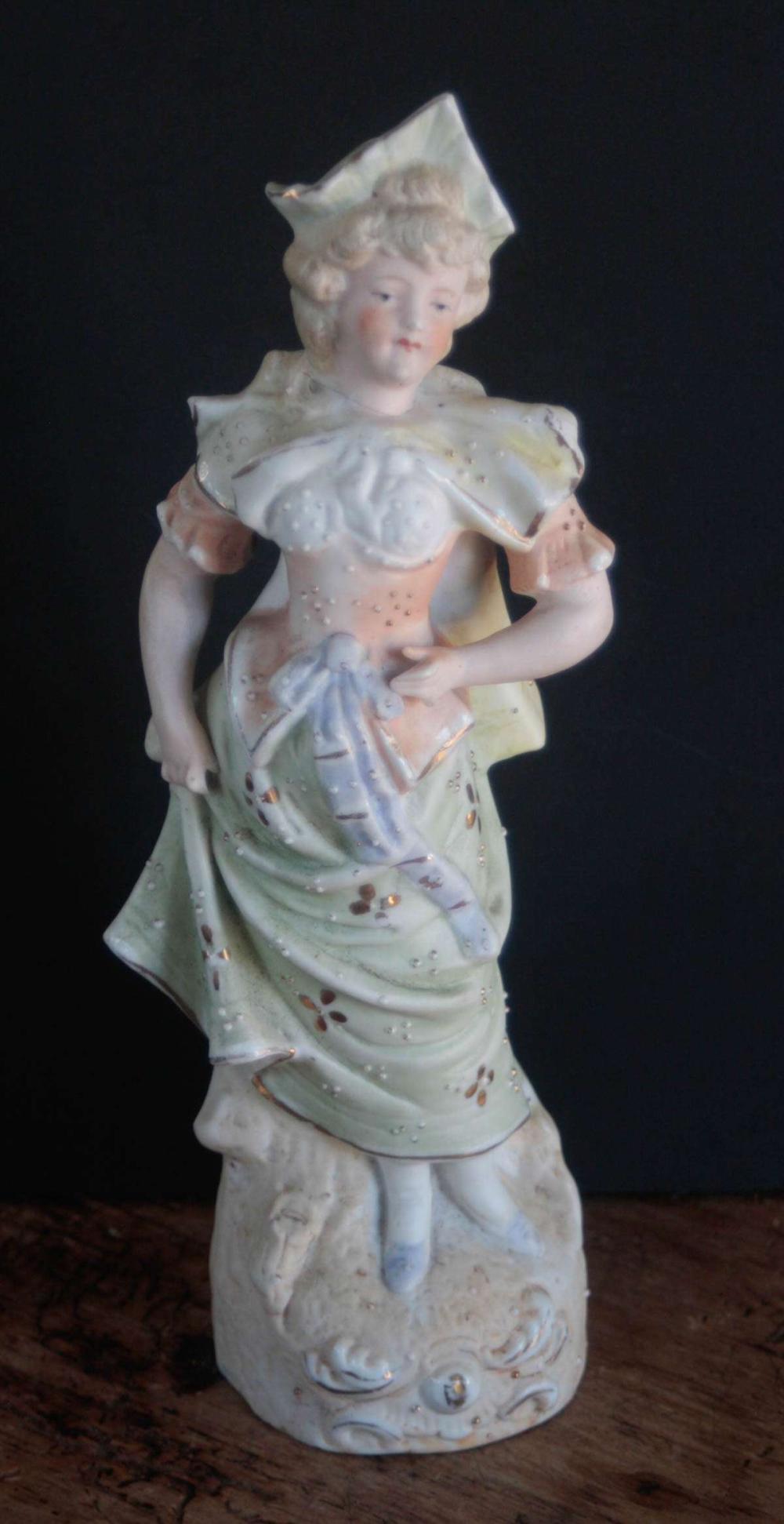 antique bisque figural statue