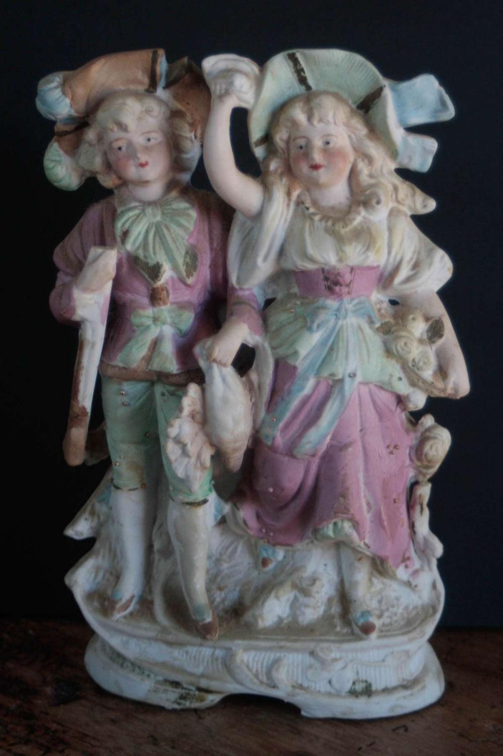 antique bisque figural hunting statue