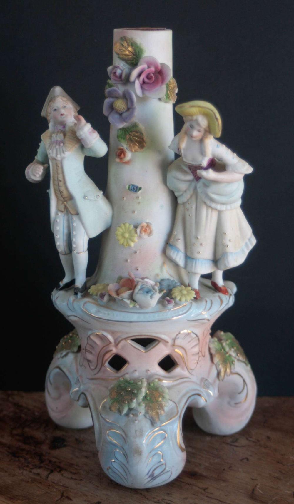 antique bisque figural candlestick