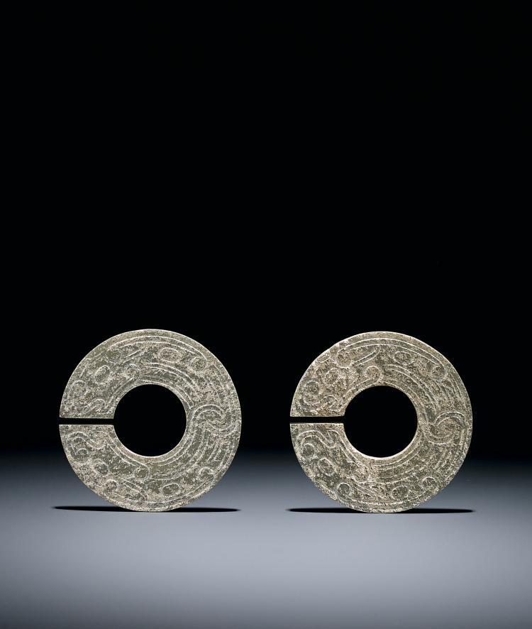 A Pair of Celadon Jade 'Dragon' Slit Rings, Jue Western Zhou Dynasty