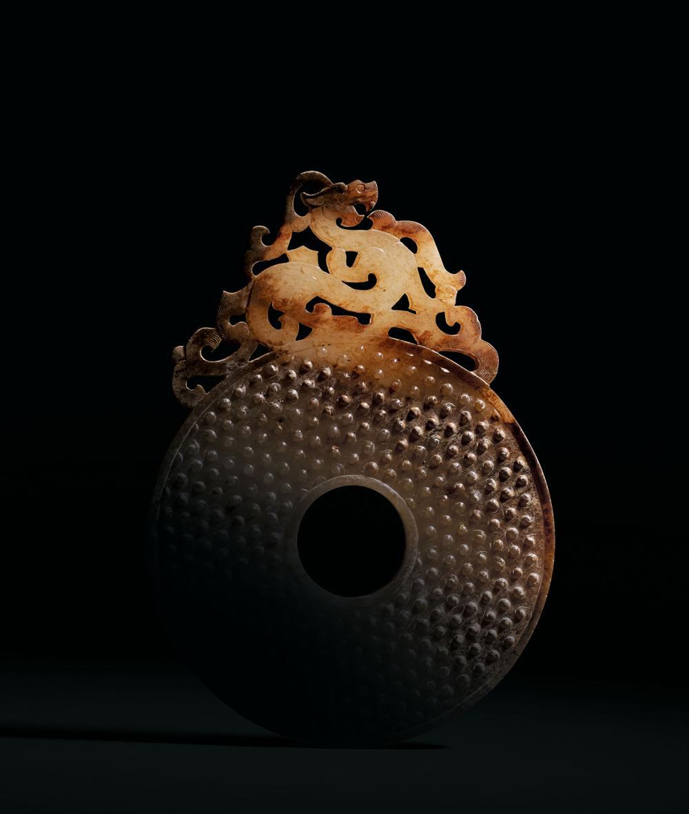漢 白玉螭龍臥蠶紋出廓璧 A Rare White and Russet Jade 'Dragon' 'BI' Disc, Han Dynasty