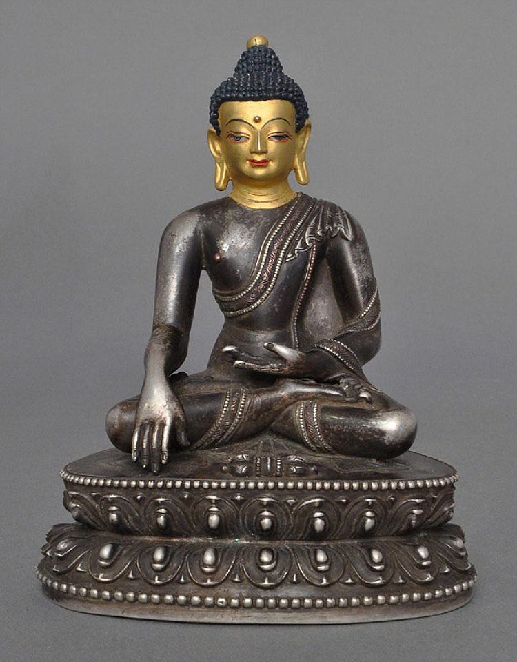 A Rare Sino-Tibetan Silver Akshobhya, 17th C.
