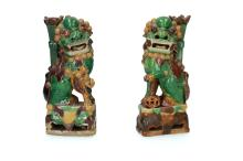 A pair of Famille Verte biscuit porcelain insence holders modelled as fo-dogs with a cub and brocade ball. China, Kangxi or Yongzheng, ca. 1680 - 1730. H. 19,5 cm. Provenance: H.A.D. Thomas Amsterdam, 1966. Exhibited: Museum Zutphen, Kien Lung, 1992-3, no. 20.