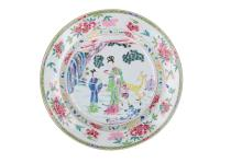 A large Famille Rose dish with a decor of a long Eliza in a garden with her attendant, standing by a pine tree and a yellow deer. Inner and outer borders with floral decor. Unmarked. China, Yongzheng, ca. 1730. Diam. 35,5 cm. Exhibited: Zuthpen Museum, 'Kien Lung vroege periode 1992-3'.
