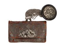 A leather tabacco pouch with wooden and silver manju, silver clasp with dragon. Japan, 19th century. L. pouch 12,5 cm.