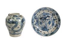 A Martavan jar with floral decor. Unmarked. H. 26 cm. Added a Swatov charger with floral decor. Unmarked. Diam. 34 cm. China, Ming.