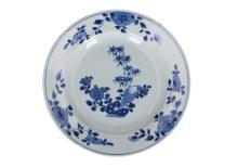 A set of nine blue and white porcelain dishes with decor of the three friends of winter. Unmarked. China, 18th century. Diam. 23 cm.