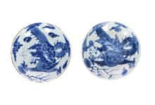 A pair of blue and white porcelain small dishes, decorated with a dragon chasing the burning pearl. Marked with 6-character mark. China, Yongzheng. Diam. 16,5 cm.