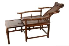 A Hongmu 'moongazing' chair with sliding foot rest. China, ca. 1900. H. 83 cm. H. seat 45 cm.