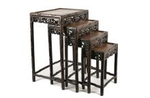 A set of four ironwood side tables. China, ca. 1900. H. 41,5 - 71,5 cm.