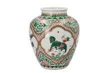 A Wucai porcelain jar decorated with mythical creatures. Unmarked. China, 19th century. H. 31 cm.