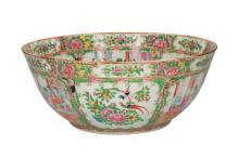 A large polychrome porcelain bowl decorated with several scenes with figures, birds and flowers. Unmarked. China, Canton, 19th century. H. 15,5 cm. Diam. 37 cm.