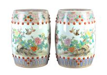 A lot of two Famille Rose porcelain garden seats, decorated with flowers and birds. Unmarked. China, 20th century. H. 48,5 cm. Provenance: bought in Shanghai, 1981.