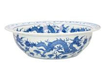 A blue and white porcelain large bowl, decorated with dragons and flowers. Unmarked. China, 20th century. Diam. 38 cm. Provenance: bought in The Netherlands, 1990.