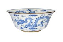 A large blue and white porcelain bowl with metal mount, decorated with dragons and clouds. Unmarked. China, 20th century. H. 16 cm. Diam. 38 cm. Provenance: bought in Vancouver, 1988.