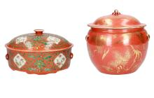 A lot of a coral red and gold porcelain lidded jar, decorated with flowers and bird, marked with seal mark, and a coral red polychrome porcelain lidded jar, unmarked. China, 20th century. H. 15 - 21 cm.