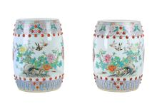 A lot of two polychrome porcelain garden seats, decorated with flowers and birds. Unmarked. China, 20th century. H. 49 cm.