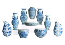 A lot of 10 various blue and white porcelain wall ornaments, including vase shaped and jar shaped ornaments, decorated with flowers. Unmarked. China, 20th century. H. 3,5 - 17 cm. Provenance: some exhibited and on loan to the Leiden Museum of Ethnology.
