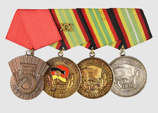 Ordensspange mit 4 Auszeichnungen: