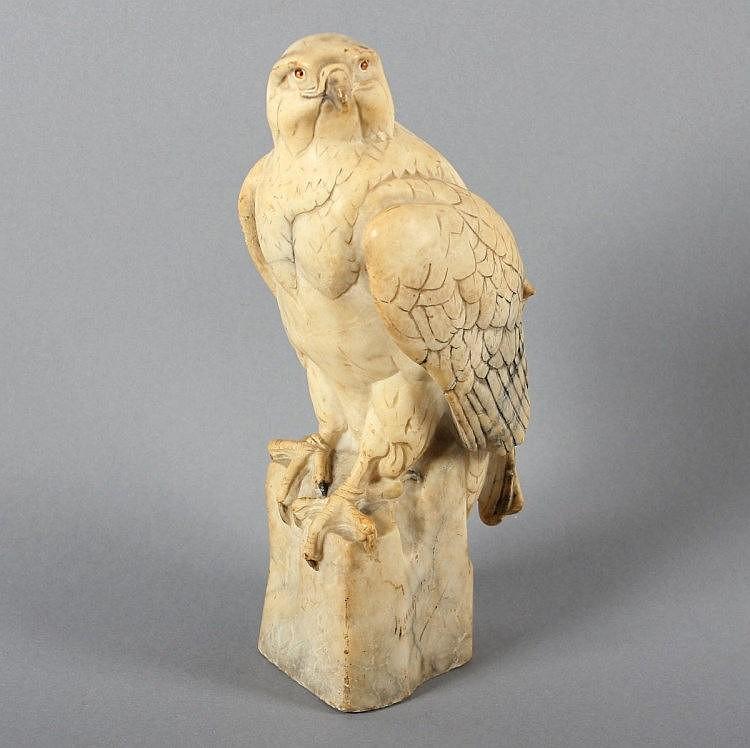 BÜSCHELBERGER, Anton, ''Sitzender Adler'', Marmalithfigur, Glasaugen, H 27, Federn hinten best., sei