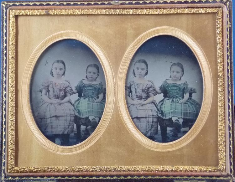 """Stereoscopic ambrotype of 1/6 plate """"Hermanas"""", colored and with gold details painted by hand. 1/2 plate morocco case manufactured by MASCHER'S USA."""