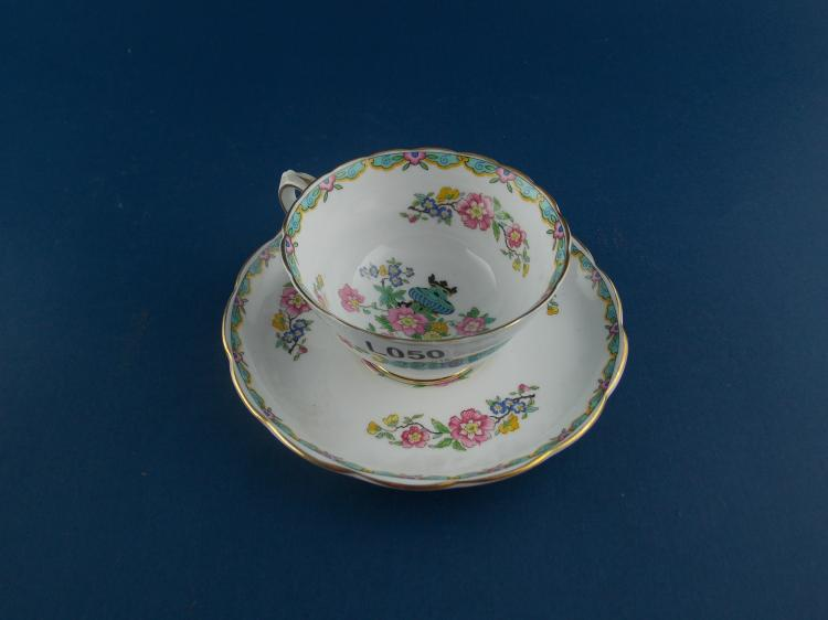 AN ENGLISH PORCELAIN COFFEE-CUP AND SAUCER SET