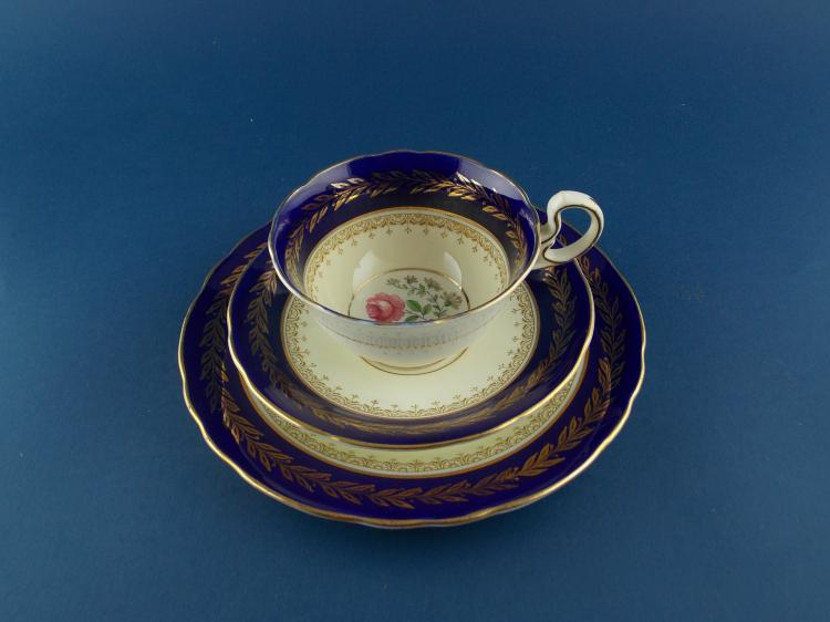 AN ENGLISH EARTHENWARE TEACUP AND SAUCER SET