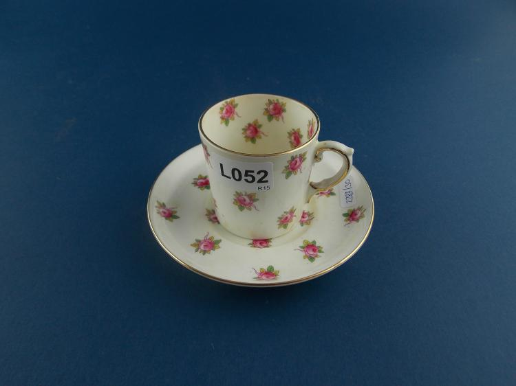 AN ENGLISH EARTHENWARE COFFEE-CUP AND SAUCER SET