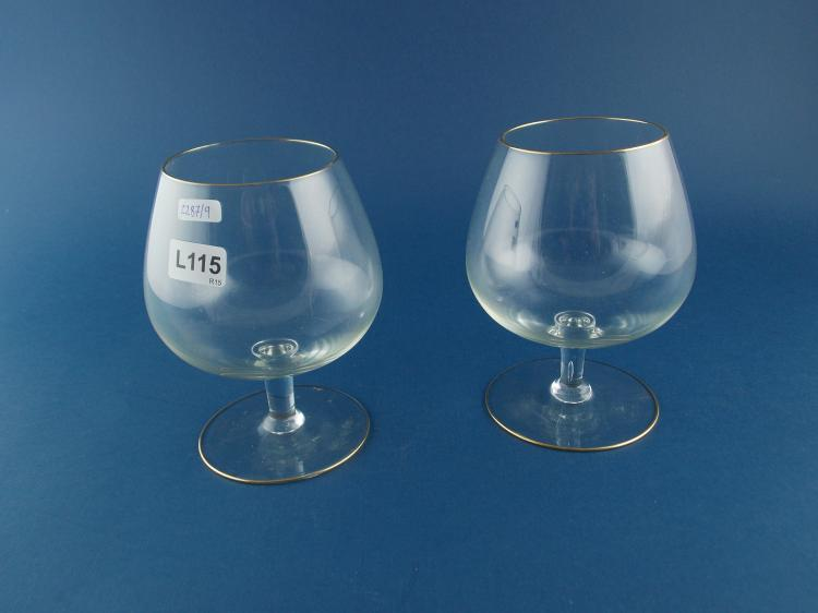 A SET OF CUT-CRYSTAL COGNAC GLASSES