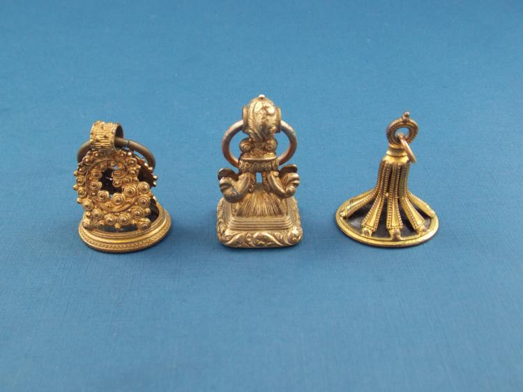THREE ANTIQUE GILT BRONZE AND AGATE SEAL STAMPS