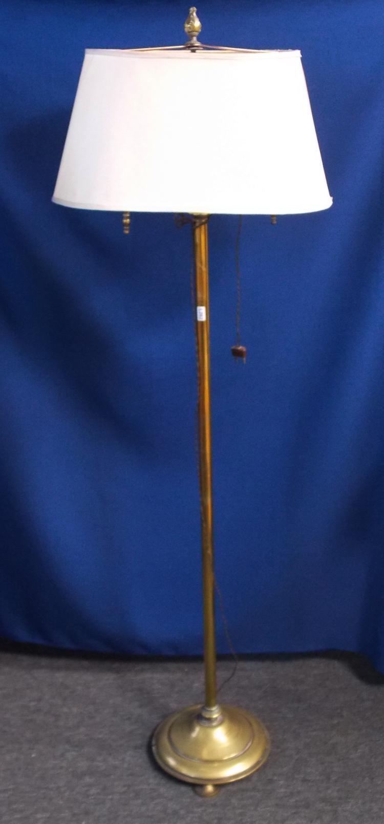 A BRONZE FLOOR LAMP