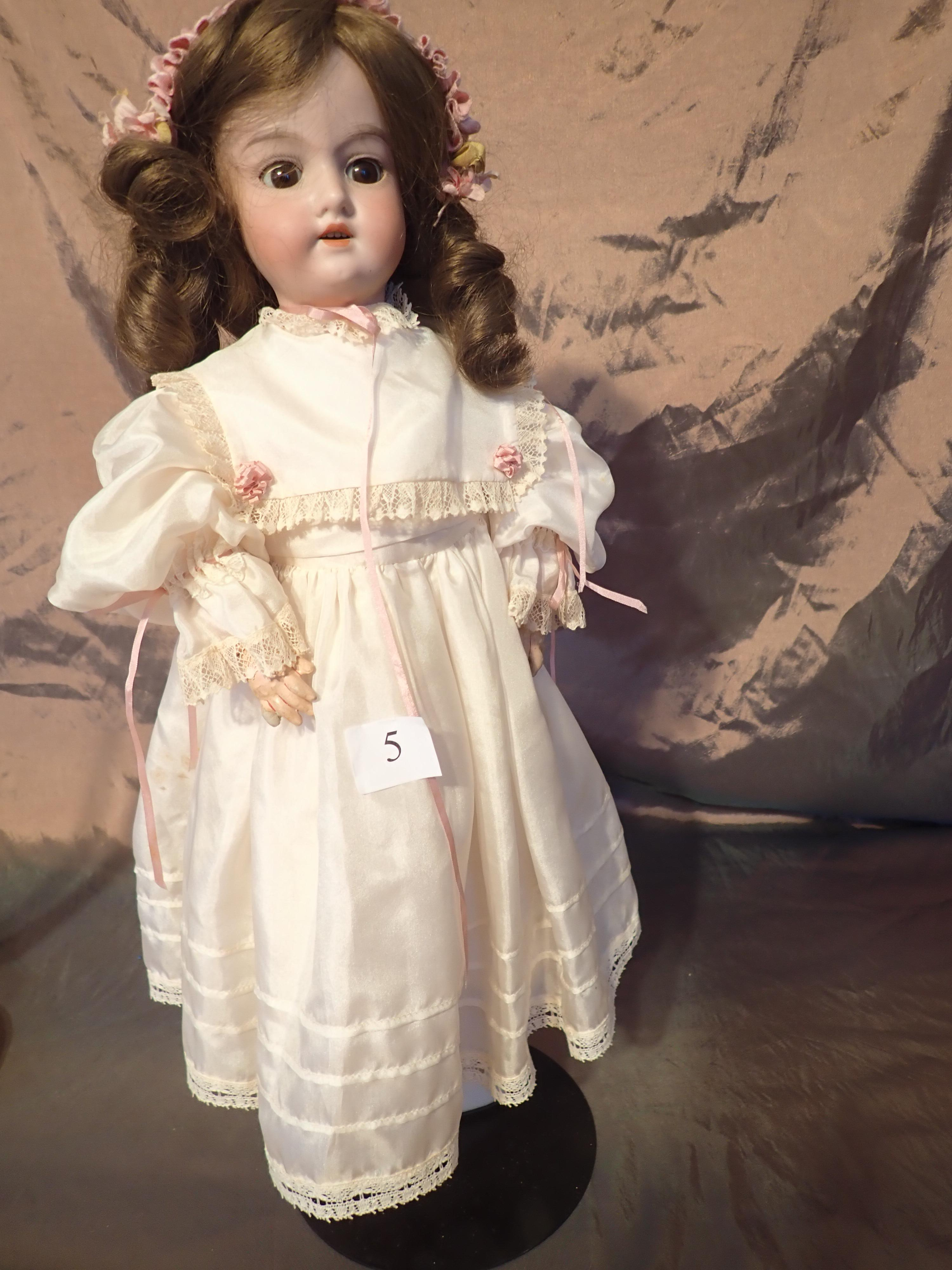 """20"""" GERMANY PORCELAIN HEADED DOLL MARKED 390 A2M - NICELY DRESSED WITH A NICE LINEN DRESS AND PANTALOONS, SHOES, & SOCKS & HEAD RIBBON - IN GOOD ORIGINAL CONDITION - ONE FINGER AND KNEE JOINT REPAIRED NOT PAINTED."""