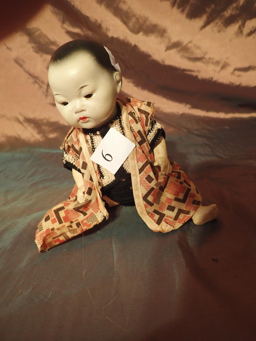 AM ORIENTAL GERMAN DOLL MARKED 353/40K - DRESSED IN ORIENTAL STYLE CLOTHES - 8 1/2 INCHES LONG - CRACK TO BACK OF BODY