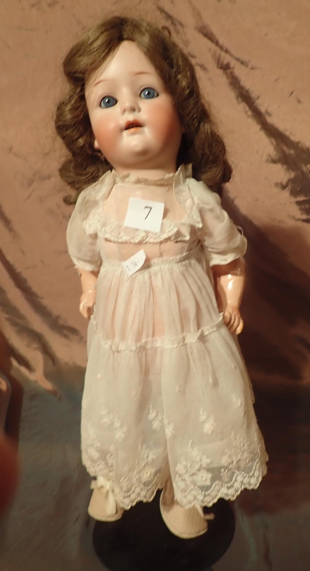 GERMAN DOLL MARKED HEUBACH KOPPELSDORF 312 SUK IN CIRCLE & 1 - HEAD HAS BEEN CRACKED TO THE REAR OTHERWISE A VERY GOOD EXAMPLE - DRESS AND PANTALOONS, SHOES & SOCKS - 17 INCHES HIGH