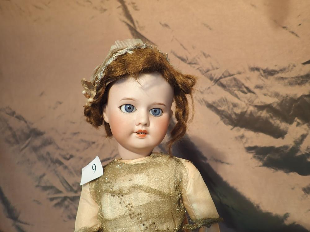 """19"""" PORCELAIN HEADED DOLL MARKED 220 SFBJ 60 PARIS NO. 3 IN ORIGINAL DRESS, PETTICOAT & PANTALOONS, SOME FADING AND TEARS TO THE DRESS - GOOD ORIGINAL CONDITION"""