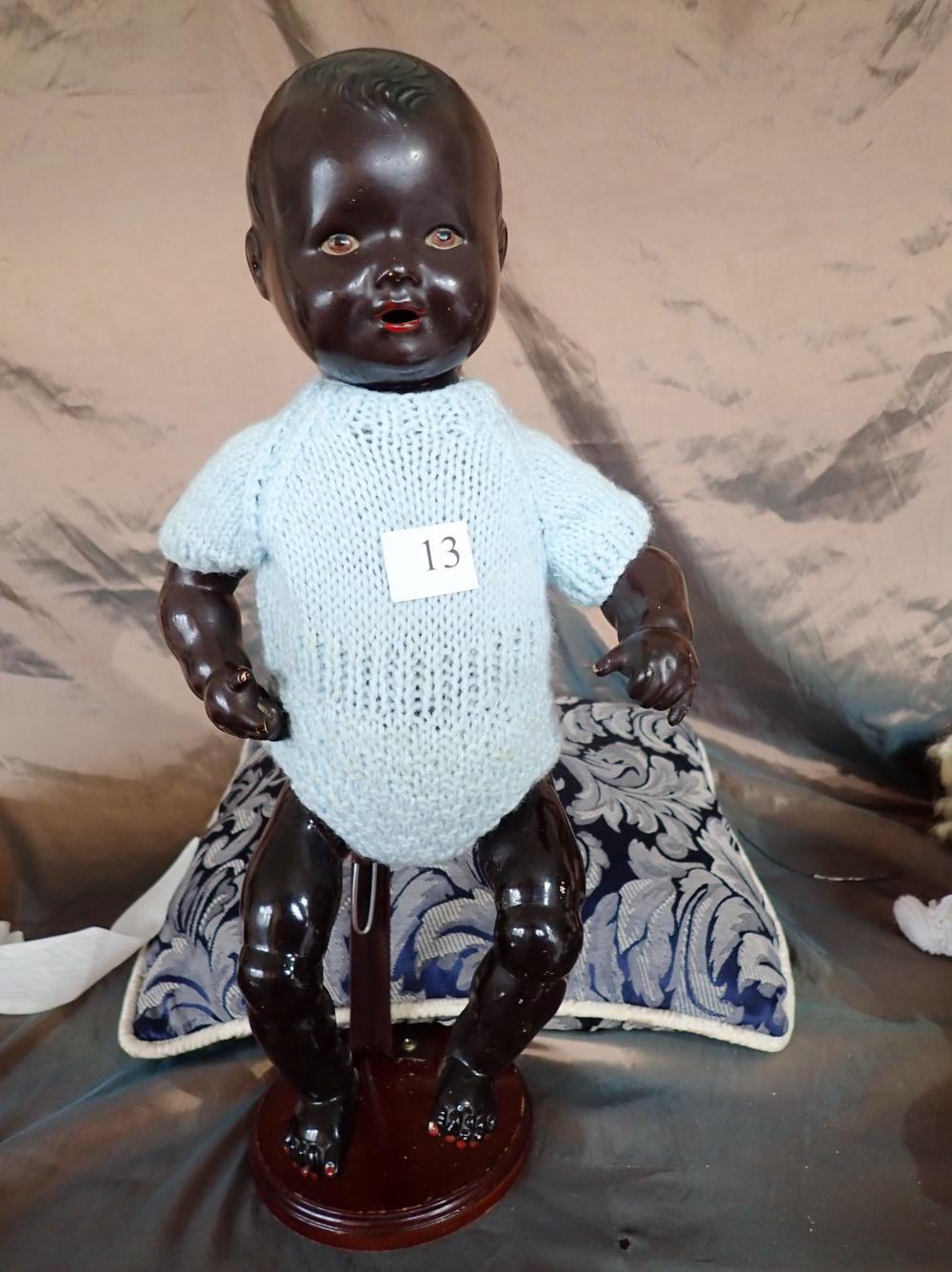 "16""BLACK CELLULOID DOLL MADE IN JAPAN, BLUE EYES, MINOR DAMAGE TO ONE FINGER & INSIDE LEG"