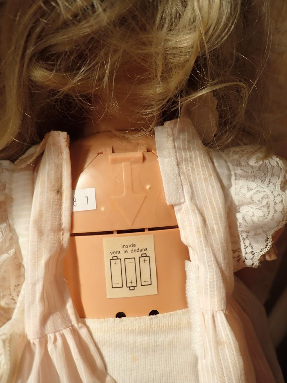"""24"""" SOFT HEAD HARD PLASTIC DOLL BATTERY OPERATED DOLL GOTZ - PUPPET ON HEAD - (MINIFOR MADE IN ITALY), BLOND HAIR BLUE EYES, SOFT PLASTIC HEAD AND HANDS, BODY HARD PLASTIC. DOLL HAS 2 BATTERY COMPARTMENTS AT FRONT AND BACK,"""