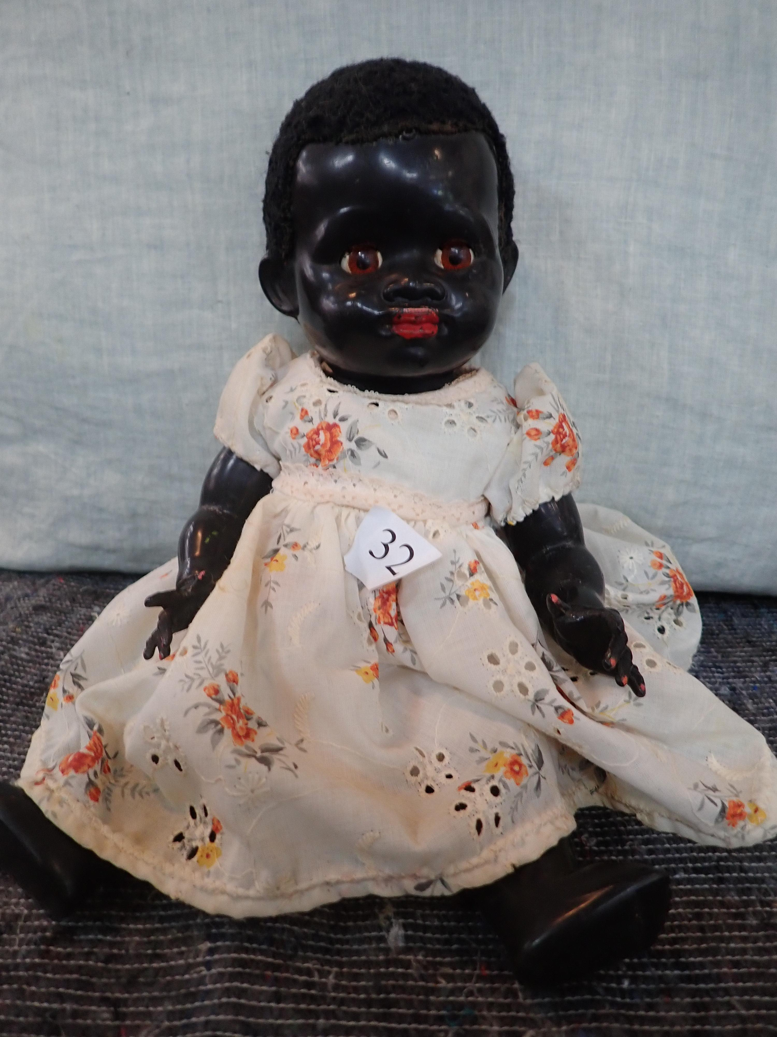 """13"""" PEDIGREE HARD PLASTIC BLACK DOLL, MADE IN ENGLAND, MOVEABLE EYES, HEAD, ARMS AND LEGS, FROM 1950'S GC WITH VOICE BOX A/F FINGER NAIL& LIPS REPAINTED"""