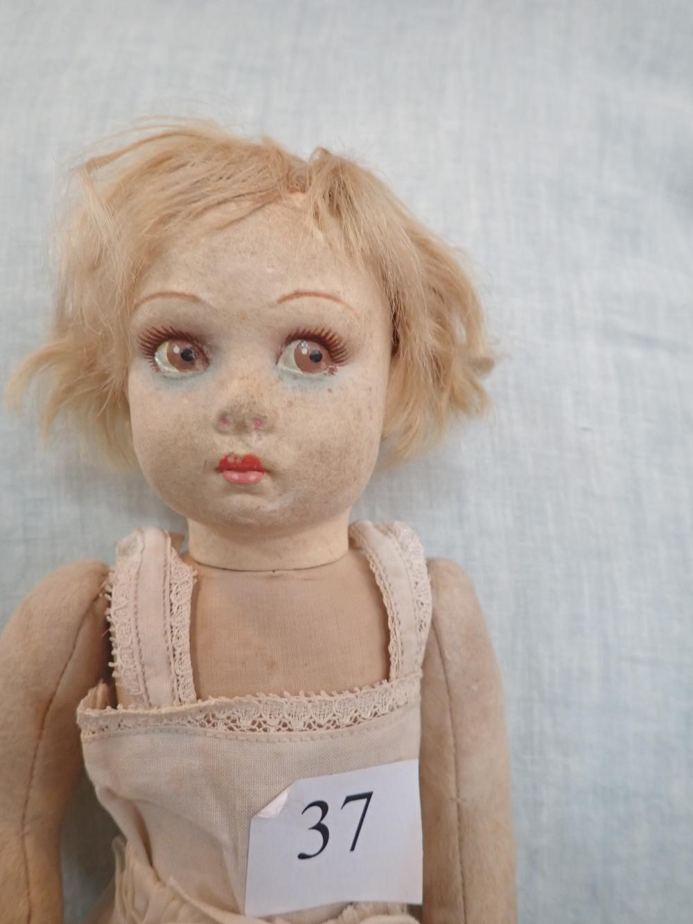 """1931 LENCI DOLL CLOTH BODY WITH FELT FACE, SWIVEL HEAD, FIXED EYES 13"""" HIGH (A) MOVEABLE LEGS ARMS SEWN TO BODY (B) 2 CENTRE FINGERS STITCHED TOGETHER © 2 DOTS ON LIPS , MARKED UNDER BOTH FEET"""