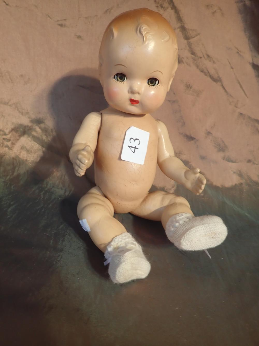 "SMALL 1930 10"" COMPOSITION BABY DOLL - DETERIORATION NEAR EARS AND TO BACK - LINEN CAP, DRESS AND PANTALOONS - EYES MOVE"
