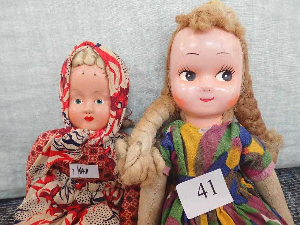 """2 DOLLS - 1) VINTAGE 12"""" HIGH RAG DOLL WITH COMPOSITION FACE 1 LEG WITH SMALL SPLIT PINNED LEGS FIXED EYES ATTRIBUTED TO POLAND (2) 11"""" VINTAGE RAG DOLL COMPOSITION FACE PAINTED EYES ATTRIBUTED TO POLAND, ORIGINAL CLOTHES"""