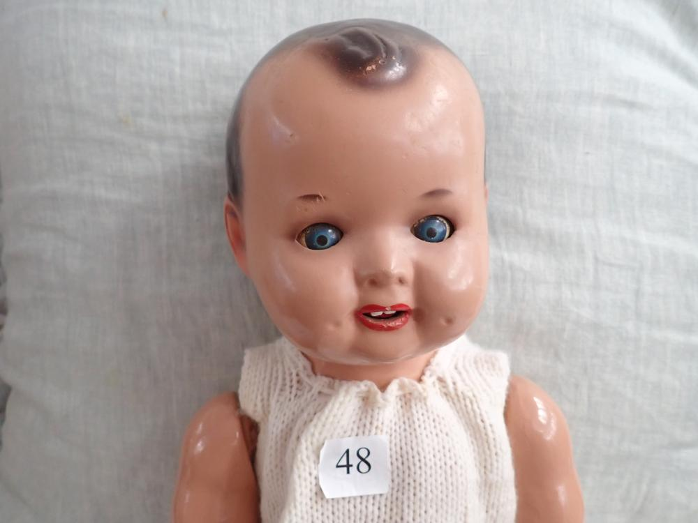 "VINTAGE 1930 22"" COMPOSITION BOY DOLL, 2 DIMPLES ON FACE, ARMS NEED RESTRINGING GC, MOVEABLE ARMS & LEGS AND HEAD, BLUE MOVEABLE EYES"